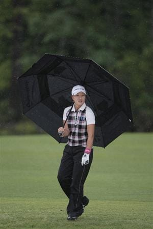 MOBILE, AL - MAY 16: Se Ri Pak of South Korea walks down the 18th fairway in the rain during a sudden death playoff in the Bell Micro LPGA Classic at the Magnolia Grove Golf Course on May 16, 2010 in Mobile, Alabama. Pak beat Suzann Pettersen and Brittany Lincicome in the playoff after the tournament was shortened to 54-holes because of rain. (Photo by Dave Martin/Getty Images)