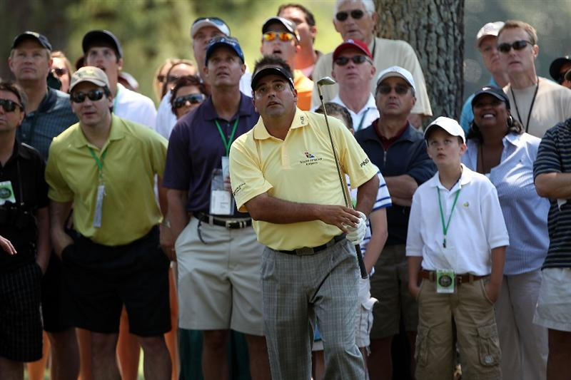 AUGUSTA, GA - APRIL 11:  Angel Cabrera of Argentina watches his shot on the first hole in front of a gallery of fans during the final round of the 2010 Masters Tournament at Augusta National Golf Club on April 11, 2010 in Augusta, Georgia.  (Photo by Andrew Redington/Getty Images)