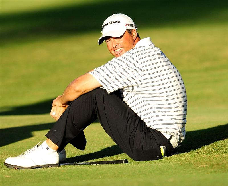 HONOLULU - JANUARY 17:  Ryan Palmer reacts after an attempted chip on the 18th hole during the final round of the Sony Open at Waialae Country Club on January 17, 2010 in Honolulu, Hawaii.  (Photo by Sam Greenwood/Getty Images)