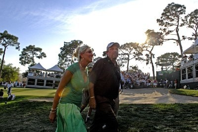 Mark Calcavecchia and his wife, Brenda, leave the 18th hole awards ceremony during the final round of the  PODS Championship at Innisbrook Resort and Golf Club in Palm Harbor, Florida on March 11, 2007. Photo by Al Messerschmidt/WireImage.com