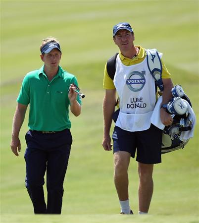 CASARES, SPAIN - MAY 21:  Luke Donald of England walks with his caddie John McLaren during his last 16 match at the Volvo World Match Play Championship at Finca Cortesin on May 21, 2011 in Casares, Spain.  (Photo by Andrew Redington/Getty Images)