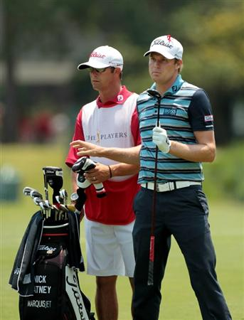 PONTE VEDRA BEACH, FL - MAY 12:  Nick Watney (R) and caddie Joel Stock (L) look on from the ninth hole during the first round of THE PLAYERS Championship held at THE PLAYERS Stadium course at TPC Sawgrass on May 12, 2011 in Ponte Vedra Beach, Florida.  (Photo by Scott Halleran/Getty Images)