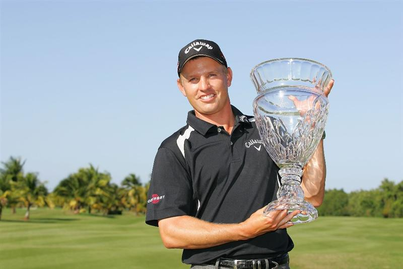 RIO GRANDE, PR - MARCH 15:  Derek Lamely holds the trophy after winning the Puerto Rico Open presented by Banco Popular at Trump International Golf Club held on March 15, 2010 in Rio Grande, Puerto Rico.  (Photo by Michael Cohen/Getty Images)