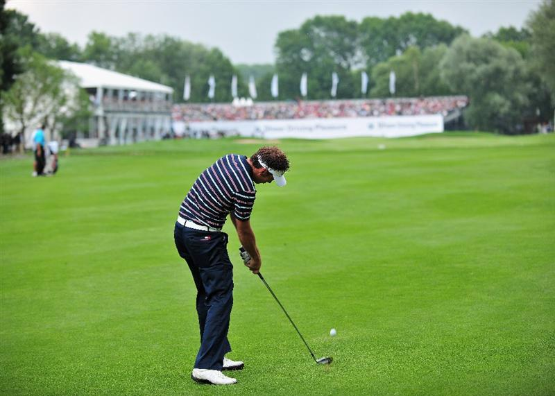 MUNICH, GERMANY - JUNE 28:  Nick Dougherty of England hits his approach shot on the 18th hole during the final round of The BMW International Open Golf at The Munich North Eichenried Golf Club on June 28, 2009, in Munich, Germany.  (Photo by Stuart Franklin/Getty Images)