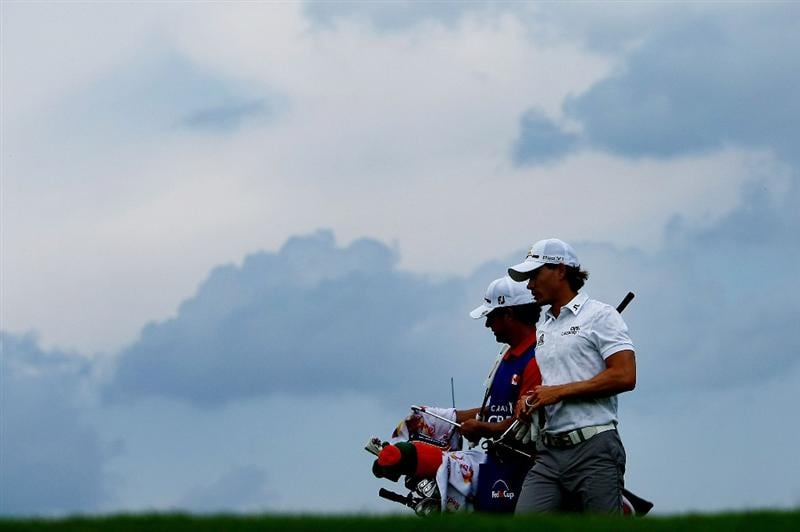 OAKVILLE, ONTARIO - JULY 24:  Camilo Villegas of Columbia walks off the fourth tee with his caddie before play was suspended due to lightning strikes  during round two of the RBC Canadian Open at Glen Abbey Golf Club on July 24, 2009 in Oakville, Ontario, Canada.  (Photo by Chris McGrath/Getty Images)
