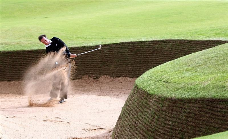 KINGSBARNS, UNITED KINGDOM - OCTOBER 01:  Former England cricket caption Michael Vaughan plays out from a bunker on the third hole during the final practice round of The Alfred Dunhill Links Championship at Kingsbarns Golf Links on October 1, 2008 in Kingbarns, Scotland.  (Photo by Ross Kinnaird/Getty Images)