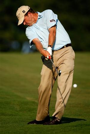 GREENSBORO, NC - AUGUST 23:  Jason Bohn hits a shot from the rough on the 18th hole during the final round of the Wyndham Championship at Sedgefield Country Club on August 23, 2009 in Greensboro, North Carolina.  (Photo by Streeter Lecka/Getty Images)