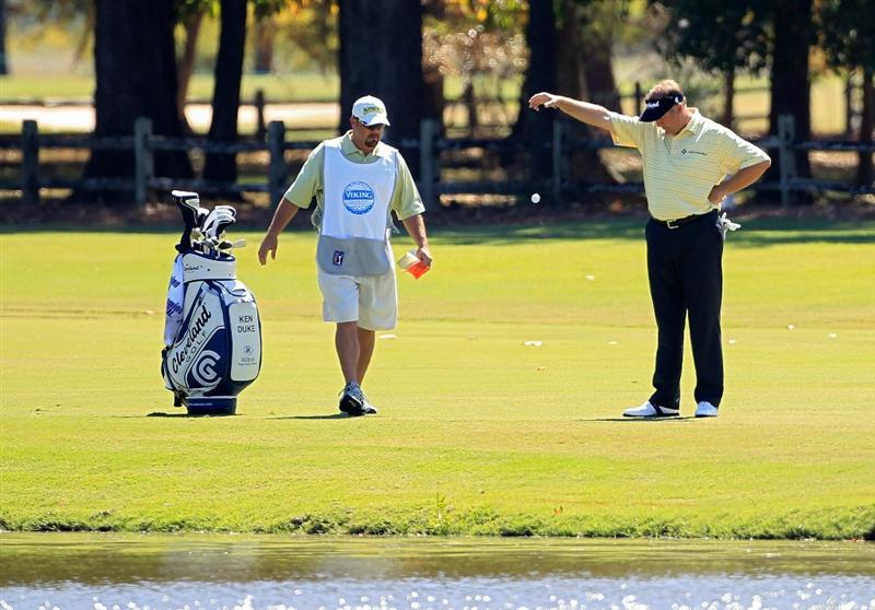 MADISON, MS - SEPTEMBER 30:  Ken Duke takes a drop on the 17th fairway after hitting his drive in the water during the first round of the Viking Classic held at Annandale Golf Club on September 30, 2010 in Madison, Mississippi.  (Photo by Michael Cohen/Getty Images)