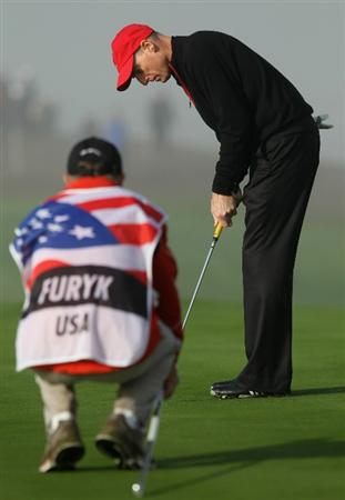 NEWPORT, WALES - OCTOBER 04:  Jim Furyk of the USA lines up a putt with his caddie Mike Cowan on the first green in the singles matches during the 2010 Ryder Cup at the Celtic Manor Resort on October 4, 2010 in Newport, Wales.  (Photo by Ross Kinnaird/Getty Images)