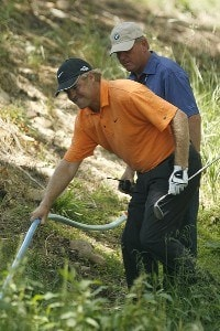 Richard Johnson moves a hose as he hits from the rightside of a creek on the 13th fairway in the final round of the 2007 BMW Charity Pro-Am at The Cliffs at The Valley Course Travelers Rest, South Carolina on May 20, 2007. Nationwide Tour - 2007 BMW Charity Pro-Am at the Cliffs - Final RoundPhoto by Steve Grayson/WireImage.com