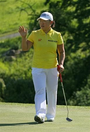 GLADSTONE, NJ - MAY 20 : Jiyai Shin of South Korea waves to the crowd after finishing her match on the 16th hole during the first round of the Sybase Match Play Championship at Hamilton Farm Golf Club on May 20, 2010 in Gladstone, New Jersey. (Photo by Hunter Martin/Getty Images)