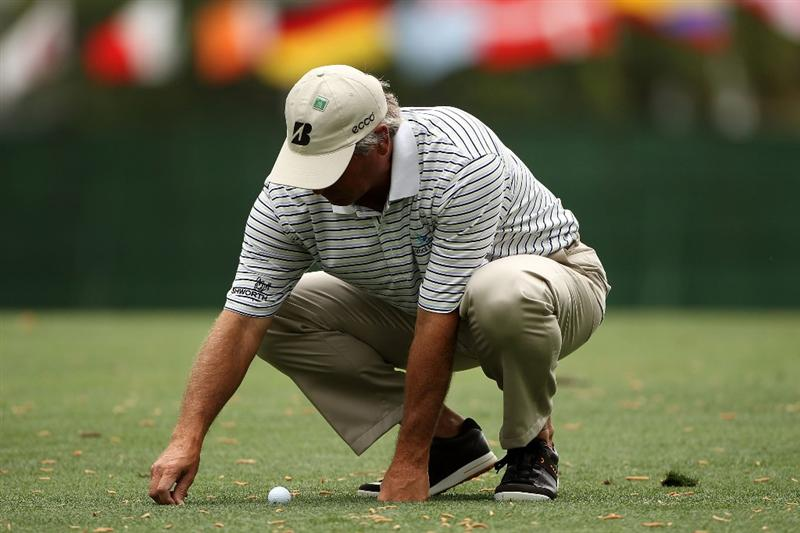 AUGUSTA, GA - APRIL 08:  Fred Couples picks up some loose impediments on the first hole during the first round of the 2010 Masters Tournament at Augusta National Golf Club on April 8, 2010 in Augusta, Georgia.  (Photo by Andrew Redington/Getty Images)