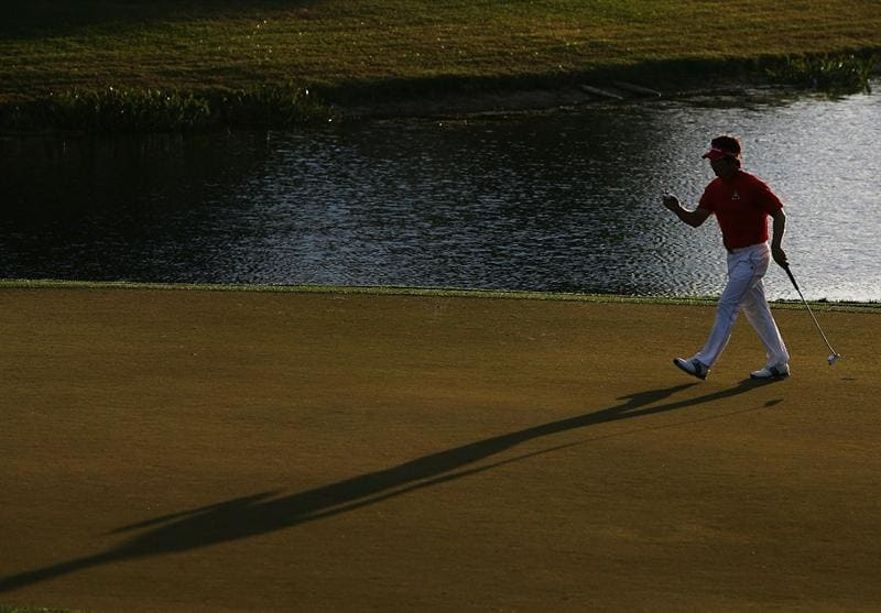 PALM BEACH GARDENS, FL - MARCH 07:  Y.E. Yang waves to the crowd after making his par putt on the 17th hole during the third round of The Honda Classic at PGA National Resort and Spa on March 7, 2009 in Palm Beach Gardens, Florida.  (Photo by Doug Benc/Getty Images)