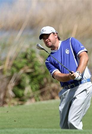ORLANDO, FL - MARCH 14:  Graeme McDowell of Northern Ireland plays a shot on the 6th hole during the first day of the Tavistock Cup at Isleworth Golf and Country Club on March 14, 2011 in Orlando, Florida.  (Photo by Sam Greenwood/Getty Images)