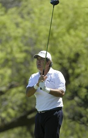 PARKER, CO. - MAY 30: David Frost of South Africa tees off the 18th hole during the fourth and final round of the Senior PGA Championship at the Colorado Golf Club on May 30, 2010 in Parker, Colorado.  (Photo by Marc Feldman/Getty Images)