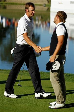 LEMONT, IL - SEPTEMBER 12:  (L-R) Dustin Johnson shakes hands with Ryan Moore after Johnson won the BMW Championship at Cog Hill Golf & Country Club on September 12, 2010 in Lemont, Illinois.  (Photo by Scott Halleran/Getty Images)