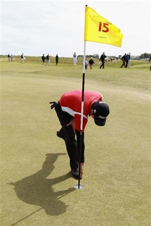 GULLANE, SCOTLAND - JUNE 18:  Jin Jeong of Korea retrieves his ball from the hole after an eagle on the 15th hole during his Quarter Final match against Paul Cutler of Northern Ireland for The Amateur Championship at Muirfield Golf Club on June 18, 2010 in Gullane, Scotland.  (Photo by Warren Little/Getty Images)