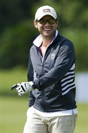 HAIKOU, CHINA - OCTOBER 29:  Actor Christian Slater smiles on the 12th green during day three of the Mission Hills Start Trophy tournament at Mission Hills Resort on October 29, 2010 in Haikou, China. The Mission Hills Star Trophy is Asia's leading leisure liflestyle event which features Hollywood celebrities and international golf stars.  (Photo by Victor Fraile/Getty Images for Mission Hills)