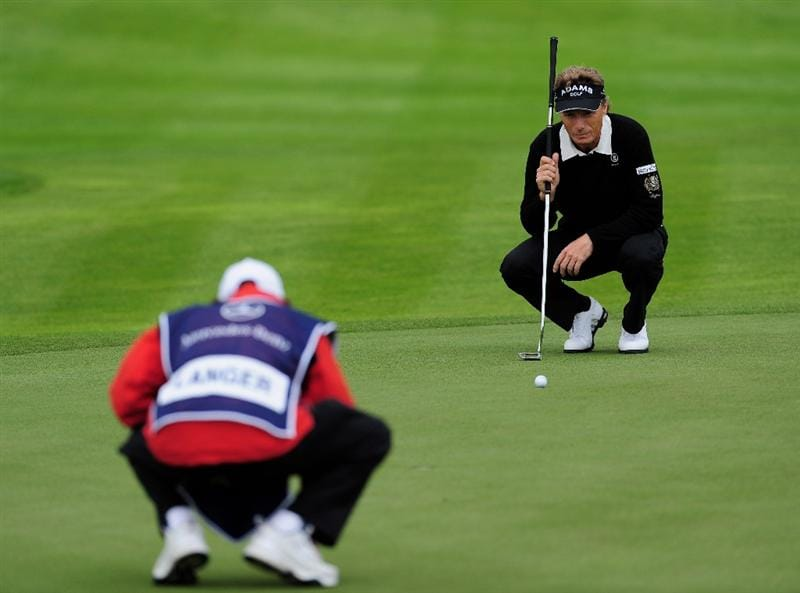 COLOGNE, GERMANY - SEPTEMBER 10:  Bernhard Langer of Germany and caddie line up a putt on the nineth hole during the first round of The Mercedes-Benz Championship at The Gut Larchenhof Golf Club on September 10, 2009 in Cologne, Germany.  (Photo by Stuart Franklin/Getty Images)