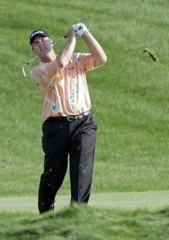 Tom Purtzer hits his third shot to the par 5 18th hole on his way to winning the 3M Championship, August 7, 2005, held at the TPC of the Twin Cities, Blaine, Minnesota. Purtzer finished -15 holding off Craig Stadler and Lonnie Nielsen for a one shot victory.Photo by Gregory Shamus/WireImage.com