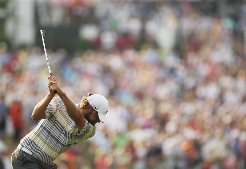 CHARLOTTE, NC - MAY 08:  Lucas Glover hits his approach shot on the first playoff hole during the final round of the Wells Fargo Championship at the Quail Hollow Club on May 8, 2011 in Charlotte, North Carolina.  (Photo by Scott Halleran/Getty Images)
