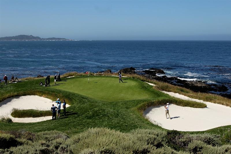 PEBBLE BEACH, CA - JUNE 16:  Golfers practice on the seventh green during a practice round prior to the start of the 110th U.S. Open at Pebble Beach Golf Links on June 16, 2010 in Pebble Beach, California.  (Photo by Ross Kinnaird/Getty Images)