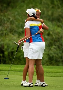 SUN CITY, SOUTH AFRICA - JANUARY 20:  Jennifer Rosales and Dorothy Delasin (front) of The Philippines celebrate victory on the 18th green during the final round of the Women's World Cup of Golf at The Gary Player Country Club on January 20, 2008 in Sun City, South Africa.  (Photo by Richard Heathcote/Getty Images)
