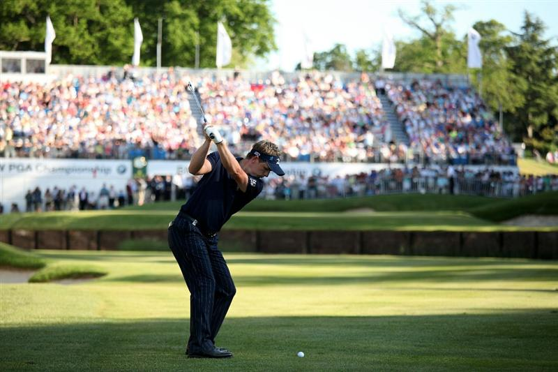 VIRGINIA WATER, ENGLAND - MAY 23:  Luke Donald of England hits his approach shot to the 18th green during the final round of the BMW PGA Championship on the West Course at Wentworth on May 23, 2010 in Virginia Water, England.  (Photo by Richard Heathcote/Getty Images)