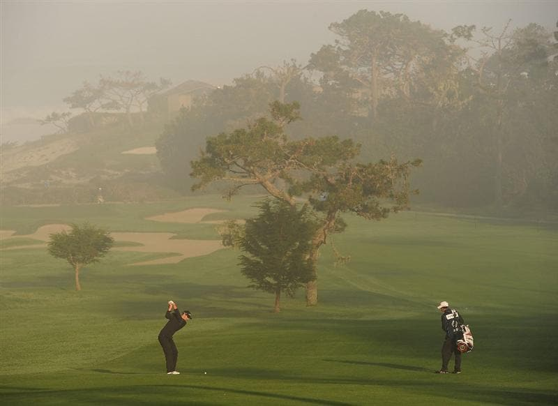 PEBBLE BEACH, CA - FEBRUARY 13:  Dustin Johnson plays his approach shot on the first hole during round three of the AT&T Pebble Beach National Pro-Am at Spyglass Hill Golf Course on February 13, 2010 in Pebble Beach, California.  (Photo by Stuart Franklin/Getty Images)