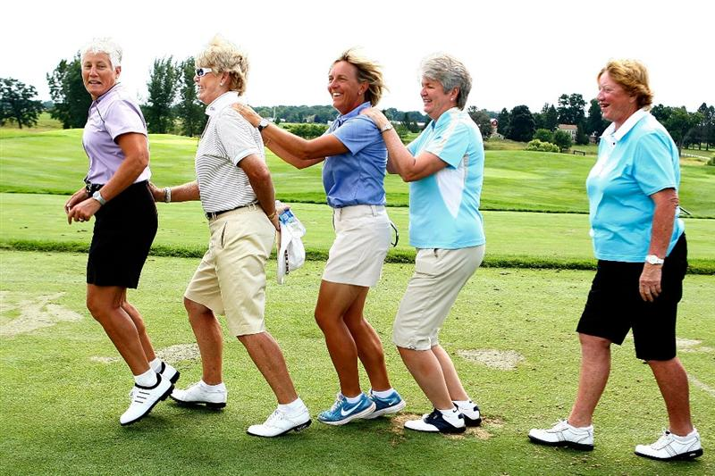 SUGAR GROVE, IL - AUGUST 19:  Two-time U.S. Team Captain Patty Sheehan leads Pat Bradley, Pia Nilsson, Alice Miller and Joanne Carner in the bunny hop at a past Solheim Cup Captain's fan session prior to the start of the 2009 Solheim Cup at Rich Harvest Farms on August 19, 2009 in Sugar Grove, Illinois.  (Photo by Scott Halleran/Getty Images)