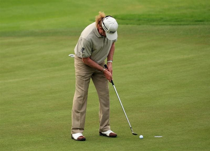 BAHRAIN, BAHRAIN - JANUARY 28:  Miguel Angel Jimenez of Spain uses an iron to putt on the 18th green after breaking his putter during the second round of the Volvo Golf Champions at The Royal Golf Club on January 28, 2011 in Bahrain, Bahrain.  (Photo by Andrew Redington/Getty Images)
