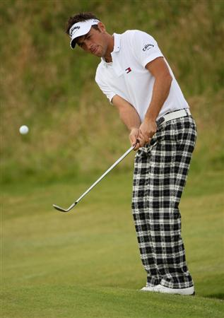 TURNBERRY, SCOTLAND - JULY 16:  Nick Dougherty of England chips during round one of the 138th Open Championship on the Ailsa Course, Turnberry Golf Club on July 16, 2009 in Turnberry, Scotland.  (Photo by Andrew Redington/Getty Images)