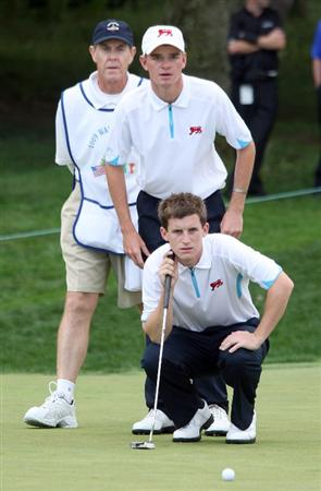 ARDMORE, PA - SEPTEMBER 13:  Chris Paisley (kneeling) and Dale Whitnell of England and the Great Britain and Ireland Team line up a putt on the 8th hole against Nathan Smith and Peter Uihlein of the USA during the morning foursome matches on the East Course at Merion Golf Club on September 13, 2009 in Ardmore, Pennsylvania.  (Photo by David Cannon/Getty Images)