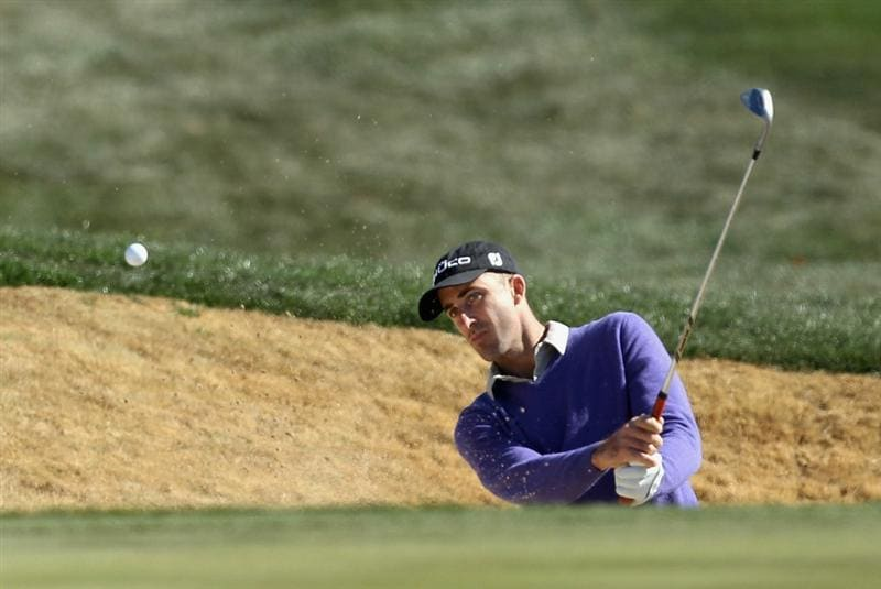 SCOTTSDALE, AZ - FEBRUARY 04:  Dustin Johnson chips out of the bunker onto the 13th hole greeen during the first round of the Waste Management Phoenix Open at TPC Scottsdale on February 4, 2011 in Scottsdale, Arizona.  (Photo by Christian Petersen/Getty Images)