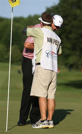 MILWAUKEE - JULY 19: Bo Van Pelt hugs his caddy Mark Chaney on the 18th hole after winning the U.S. Bank Championship on July 19, 2009 at the Brown Deer Park golf course in Milwaukee, Wisconsin. Van Pelt won on the second playoff hole. (Photo by Jonathan Daniel/Getty Images)