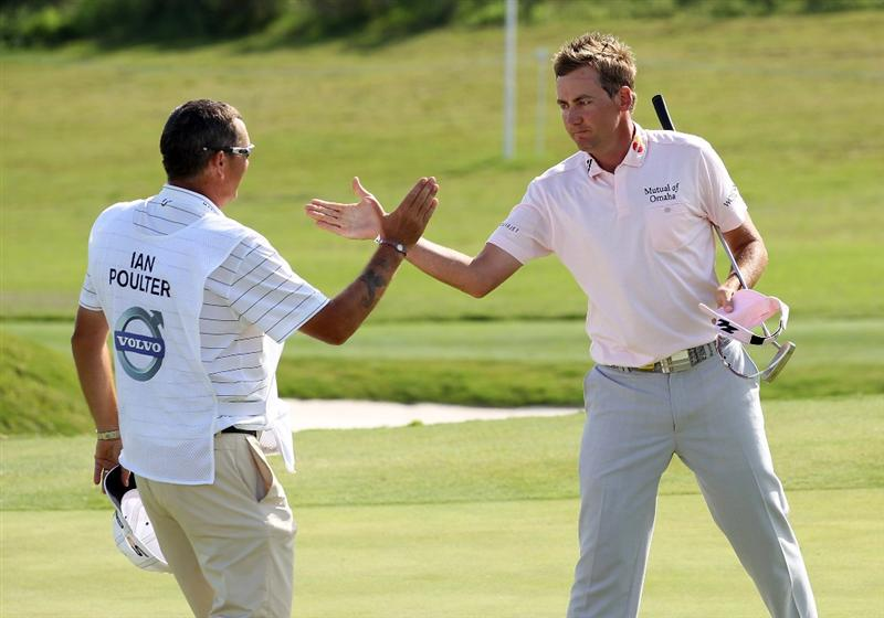 CASARES, SPAIN - MAY 22:  Ian Poulter of England celebrates with his caddie Terry Mundy after winning the Volvo World Match Play Championship at Finca Cortesin on May 22, 2011 in Casares, Spain.  (Photo by Ross Kinnaird/Getty Images)