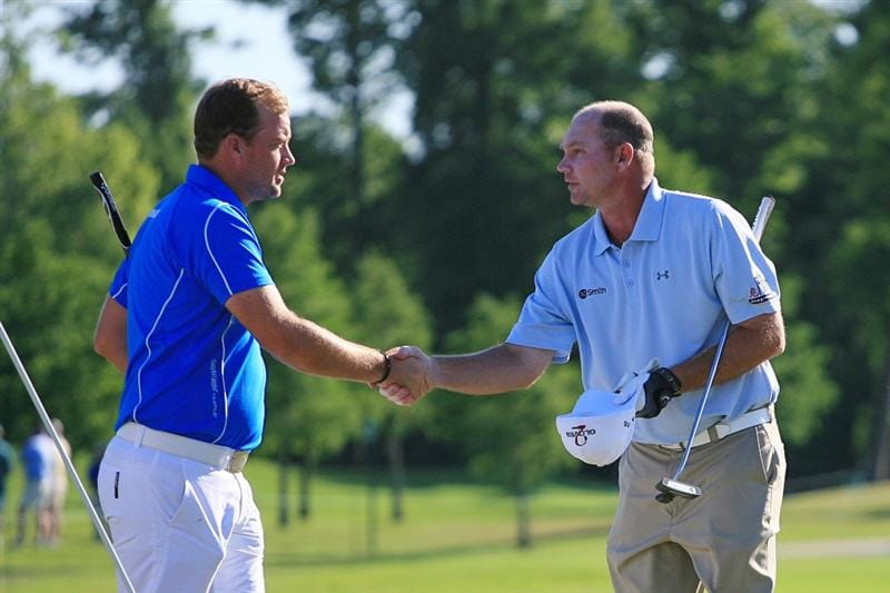 NEW ORLEANS, LA - APRIL 28 : Tommy Gainey (R) shakes hands with Peter Hanson of Sweden after they complete their round on the ninth hole during the first round of the Zurich Classic at the TPC Louisiana on April 28, 2011 in New Orleans, Louisiana. (Photo by Hunter Martin/Getty Images)