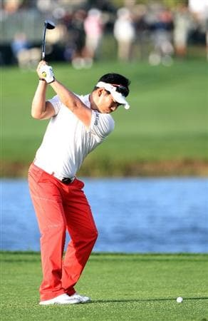PALM BEACH GARDENS, FL - MARCH 03:  Y.E. Yang of South Korea plays a shot on the 17th hole during the first round of The Honda Classic at PGA National Resort and Spa on March 3, 2011 in Palm Beach Gardens, Florida.  (Photo by Sam Greenwood/Getty Images)