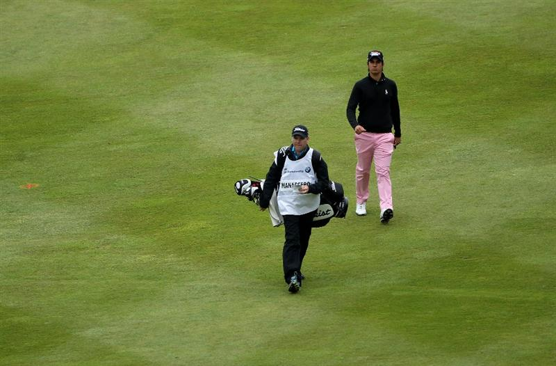 VIRGINIA WATER, ENGLAND - MAY 28:  Matteo Manassero of Italy walks down the 1st fairway with his caddie during the third round of the BMW PGA Championship at the Wentworth Club on May 28, 2011 in Virginia Water, England.  (Photo by Warren Little/Getty Images)