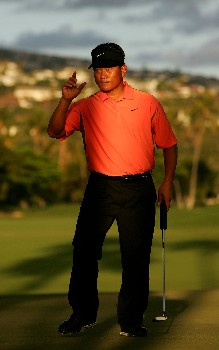 HONOLULU - JANUARY 12:  K.J. Choiwaves to the crowd after making a birdie putt on the 18th hole during the third round of the Sony Open at the Waialae Country Club on January 12, 2008 in Honolulu, Oahu, Hawaii.  (Photo by Jonathan Ferrey/Getty Images)