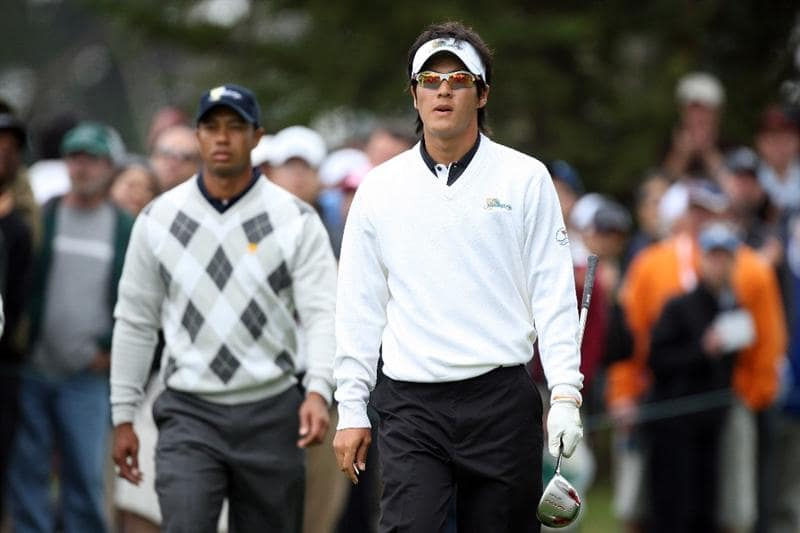 SAN FRANCISCO - OCTOBER 10: Ryo Ishikawa of Japan and the International Team walks from the 6th tee followed by Tiger Woods of the USA Team during the Day Three Afternoon Fourball Matches in The Presidents Cup at Harding Park Golf Course on October 10, 2009 in San Francisco, California  (Photo by David Cannon/Getty Images)