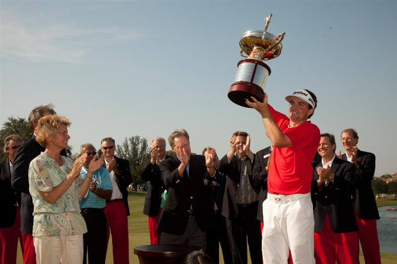 IRVING, TX - MAY 29: As Peggy Nelson (left) looks on, Keegan Bradley hoists the champion's trophy following his victory at the HP Byron Nelson Championship at TPC Four Seasons at Las Colinas on May 29, 2011 in Irving, Texas. (Photo by Darren Carroll/Getty Images)