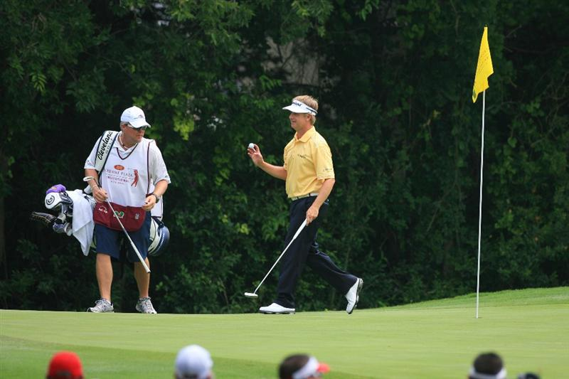 FORT WORTH, TX - MAY 22: David Toms waves to the gallery after making eagle on the 11th hole during the Crowne Plaza Invitational at Colonial Country Club on May 22, 2011 in Fort Worth, Texas. (Photo by Hunter Martin/Getty Images)