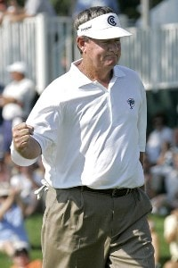 Bobby Wadkins reacts after making a putt on the 18th hole during the final round of the Ford Senior Players Championship held at TPC Michigan in Dearborn, Michigan, on July 16, 2006.Photo by Gregory Shamus/WireImage.com