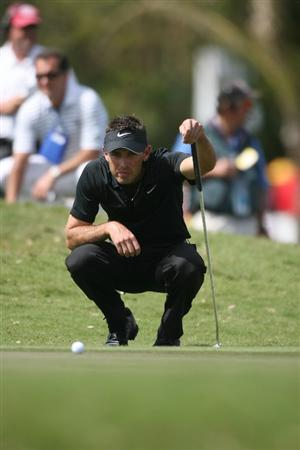 DORAL, FL - MARCH 14:  Charl Schwartzel of South Africa lines up a putt on the second hole during the final round of the 2010 WGC-CA Championship at the TPC Blue Monster at Doral on March 14, 2010 in Doral, Florida.  (Photo by Marc Serota/Getty Images)