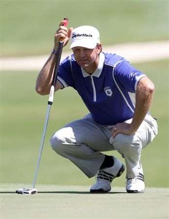 ORLANDO, FL - MARCH 14:  Retief Goosen of South Africa plays a shot on the 6th hole during the first day of the Tavistock Cup at Isleworth Golf and Country Club on March 14, 2011 in Orlando, Florida.  (Photo by Sam Greenwood/Getty Images)