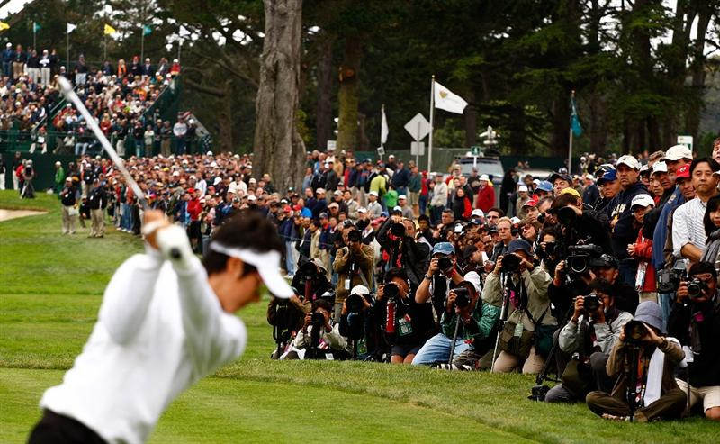 SAN FRANCISCO - OCTOBER 10:  Ryo Ishikawa of the International Team is photographed by a group of photographers on the 14th tee during the Day Three Morning Foursome Matches of The Presidents Cup at Harding Park Golf Course on October 10, 2009 in San Francisco, California.  (Photo by Scott Halleran/Getty Images)