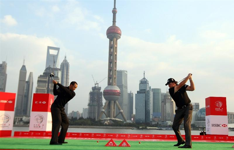 SHANGHAI, CHINA - NOVEMBER 03:  Tiger Woods and Phil Mickelson of the USA hit a shot into the Huangpu River during the the Official 2009 WGC-HSBC Photocall at the Shanghai Port International Cruise Terminal on November 3, 2009 in Shanghai, China.  (Photo by Ross Kinnaird/Getty Images)