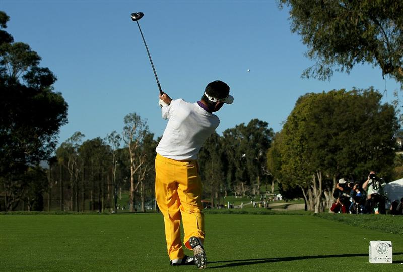 PACIFIC PALISADES, CA - FEBRUARY 17:  Yuta Ikeda of Japan hits his tee shot on the second hole during round one of the Northern Trust Open at Riviera Counrty Club on February 17, 2011 in Pacific Palisades, California.  (Photo by Stephen Dunn/Getty Images)
