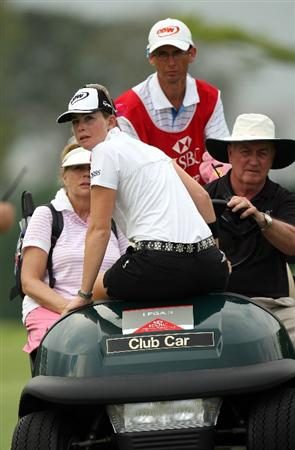 SINGAPORE - MARCH 07:  Paula Creamer of the USA makes her way back to the club house during the third round of HSBC Women's Champions at the Tanah Merah Country Club on March 7, 2009 in Singapore.  (Photo by Ross Kinnaird/Getty Images)